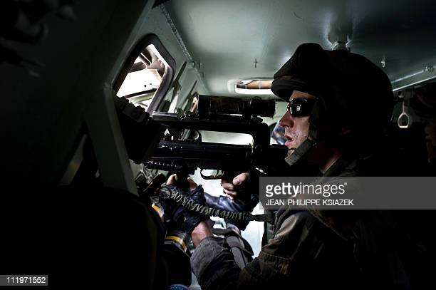 In this picture taken on April 7 2011 French soldiers involved in the evacuation of civillians patrol in Abidjan A spokesman for Ivory Coast...