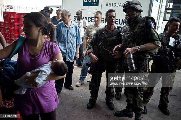 In this picture taken on April 7 2011 French soldiers supervise the evacuation of civillians in Abidjan A spokesman for Ivory Coast strongman Laurent...