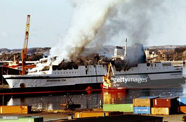 In this picture taken on April 8 1990 clouds of smoke pour from the ferry Scandanavian Star as firefighters attempt to douse the blaze as it sits in...