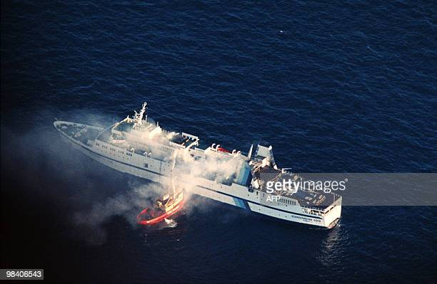 In this picture taken on April 8 1990 clouds of smoke pour from the ferry Scandanavian Star as firefighters attempt to douse the blaze in Lysekil a...