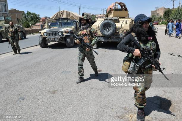 In this picture taken on August 1 Afghan National Army commando forces walk along a road amid ongoing fighting between Taliban and Afghan security...