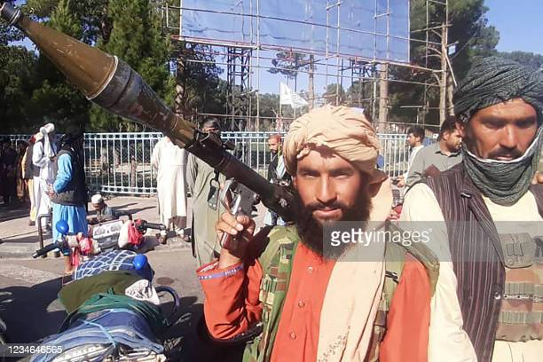 In this picture taken on August 13 a Taliban fighter holds a rocket-propelled grenade along the roadside in Herat, Afghanistan's third biggest city,...