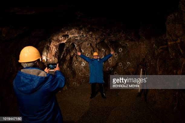 In this picture taken on August 17 2018 a visitor poses for a picture in the abandoned Kamaishi iron mine in Kamaishi Iwate prefecture When the Rugby...