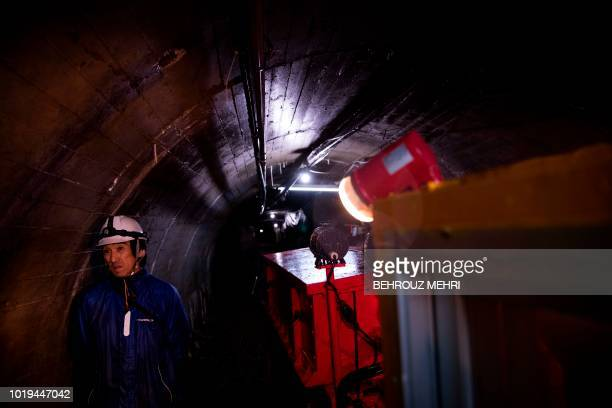 In this picture taken on August 17 2018 an employee guides a tour in the abandoned Kamaishi iron mine in Kamaishi Iwate prefecture When the Rugby...