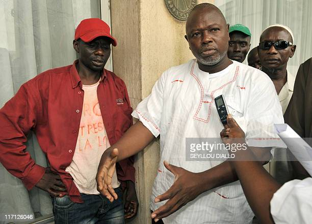 In this picture taken on August 18 2010 Alioune Tine member of African NGO for the Defense of Human Rights speaks to journalists next to Senegalese...