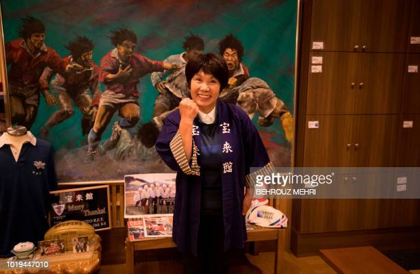 In this picture taken on August 18 2018 Japanese innkeeper Akiko Iwasaki poses at her ryokan in Kamaishi Iwate prefecture When the Rugby World Cup...