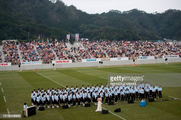In this picture taken on August 19 2018 Japanese singer Ayaka Hirahara performs with KamaishiEast junior high school students during the opening...