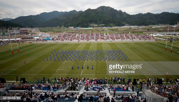 In this picture taken on August 19 2018 Japanese students perform during the opening ceremony of one of the Rugby World Cup 2019 venues the...