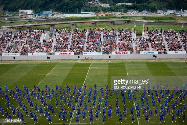 In this picture taken on August 19 2018 Japanese students perform during the opening ceremony of one of the Rugby World Cup 2019 venues the newly...