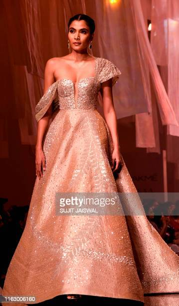 In this picture taken on August 20 2019 a model presents a creation by designer Manish Malhotra at Lakme Fashion Week Winter Festive 2019 in Mumbai /...