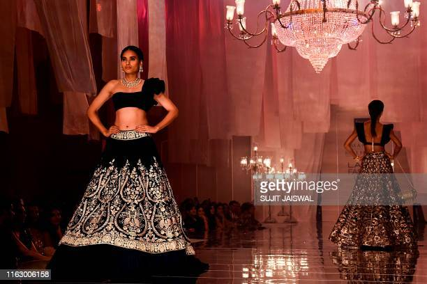 In this picture taken on August 20 2019 models present creations by designer Manish Malhotra at Lakme Fashion Week Winter Festive 2019 in Mumbai /...