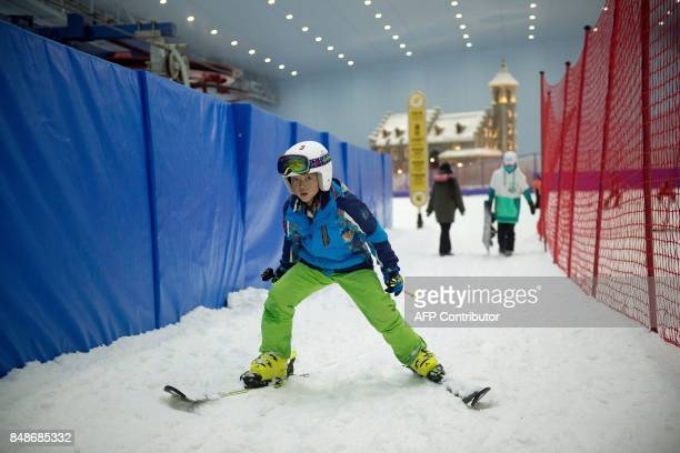 In this picture taken on August 22 a boy skis at the Wanda Harbin Ice and Snow Park in Harbin At Dalian Wanda Group's new Ice and Snow Park chilly...