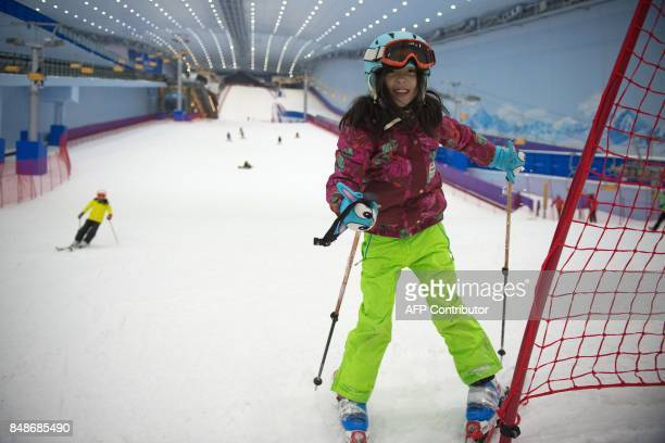In this picture taken on August 22 a girl skis at the Wanda Harbin Ice and Snow Park in Harbin At Dalian Wanda Group's new Ice and Snow Park chilly...