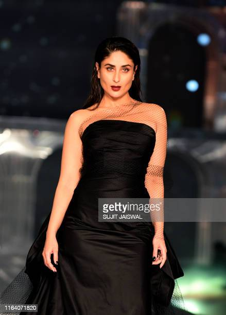In this picture taken on August 25 2019 Bollywood actress Kareena Kapoor Khan presents a creation by designers Gauri and Kanika during a fashion show...