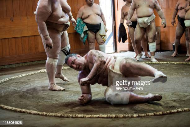 In this picture taken on August 28 Georgiaborn sumo wrestler Levan Gorgadze known by his Japanese wrestling name of Tsuyoshi Tochinoshin wretles...