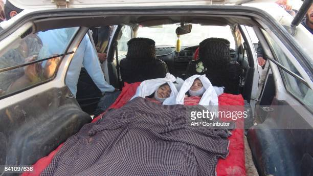 In this picture taken on August 30 2017 the dead bodies of children are seen in a car in DashteBari village in Logar province near Kabul Thirteen...