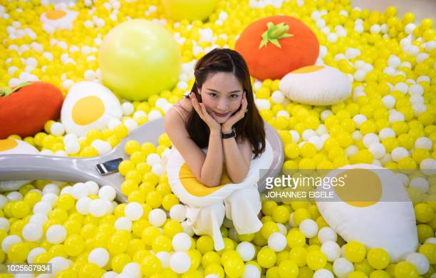 In this picture taken on August 31 a visitor poses for a photograph at the Egg House in Shanghai 'The Egg House' in Shanghai is where an apparently...