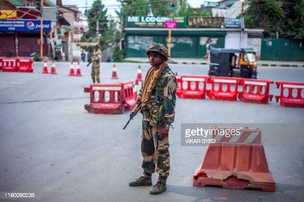 In this picture taken on August 6 2019 security personnel stand guard on a street in Srinagar Kashmir was stripped of its sevendecadelong autonomous...