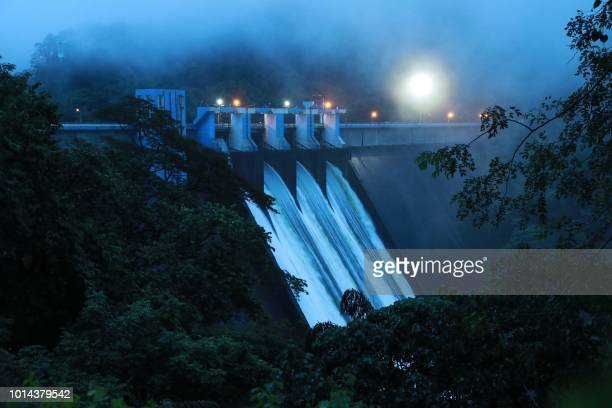In this picture taken on August 9 water gushes out of Idamalayar dam as shutters of the dam opened with the storage level crossing 169 metre the full...