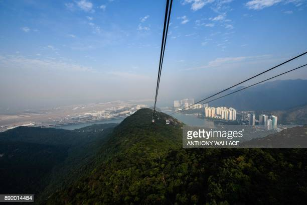 In this picture taken on December 11 a general view seen from a cable car shows a section of the Hong KongZhuhaiMacau Bridge in front of the...