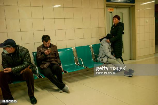 In this picture taken on December 13 patients wait in a hospital in Baoding As temperatures dipped below freezing in a northern Chinese village a...