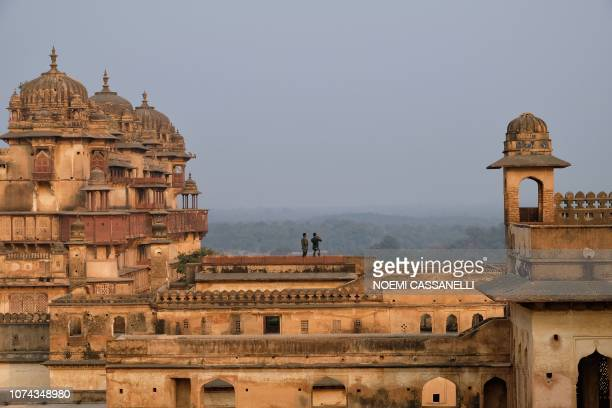 In this picture taken on December 14 Indian tourists take pictures at Orchha Fort complex in Orchha, in the Indian state of Madhya Pradesh.