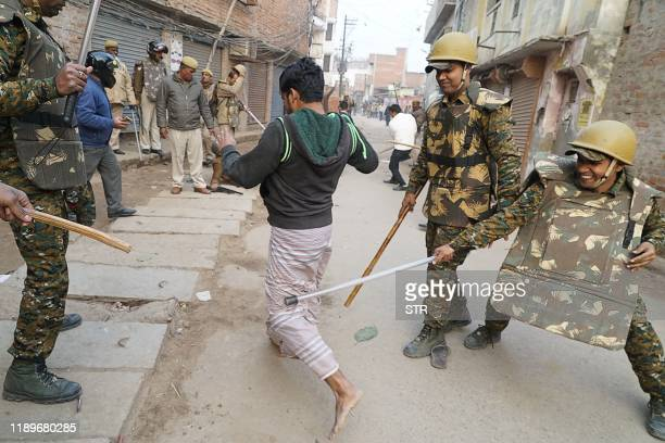 In this picture taken on December 20 police personnel clash with a protester during a demonstration against India's new citizenship law in Varanasi....