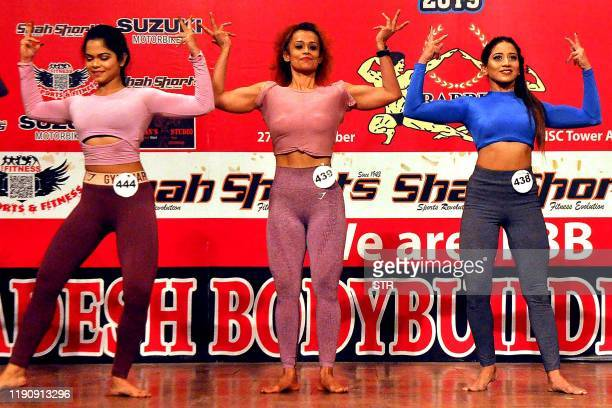 In this picture taken on December 29 competitors perform on stage during Bangladesh's first bodybuilding competition for women in Dhaka A 19yearold...