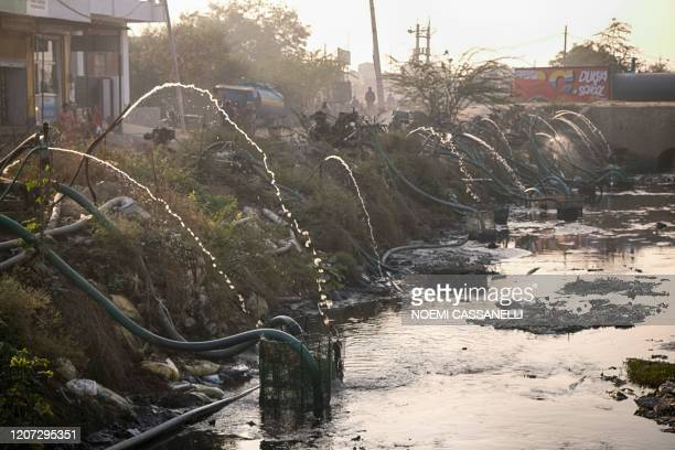 In this picture taken on December 30, 2019 pumping systems extract water from a canal where factories release their waste, in Sanganer village on the...