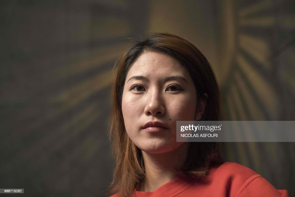 In this picture taken on December 5, 2017 Jia Xinru poses for a photo in her office lounge and coffee break area in Beijing. When Jia Xinru needed to borrow money to buy new clothes, order food and buy a projector to screen Breaking Bad on her wall, she had instant access to China's growing number of lenders via her mobile phone. Last month authorities issued new rules on microlending, designed to protect consumers and limit risk for creditors. The move was the latest aimed at tackling financial risks as the world's number two economy faces ballooning debt that has drawn warnings of a potential global financial crisis.