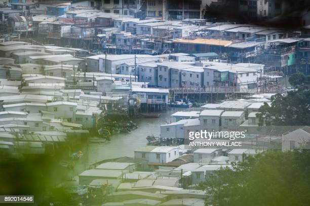 In this picture taken on December 5 a general view shows the Lantau fishing village of Tai O which overlooks the Hong KongZhuhaiMacau Bridge in Hong...