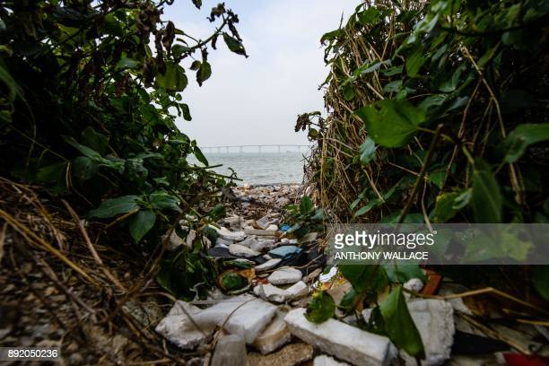 In this picture taken on December 5 a general view shows washed up litter on a bach of the Lantau fishing village of Tai O which overlooks the Hong...