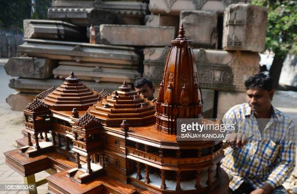In this picture taken on December 6 an Indian worker polishes a model of a proposed Hindu temple at Ram Janmabhoomi Nyas workshop in Ayodhya in...