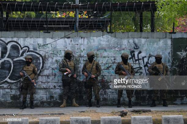 In this picture taken on February 09 soldiers guard the Legislative Assembly, in San Salvador, as supporters of Salvadoran President Nayib Bukele...