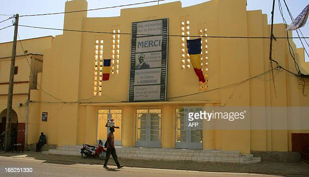 In this picture taken on February 11 2011 a man walks past 'Le Normandie' cinema in N'Djamena The cinema the only real one of its kind in the country...