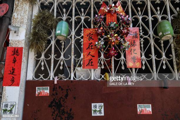In this picture taken on February 11 a home's entrance is adorned with Lunar new year decorations and four stickers reading If we don't protect Wang...