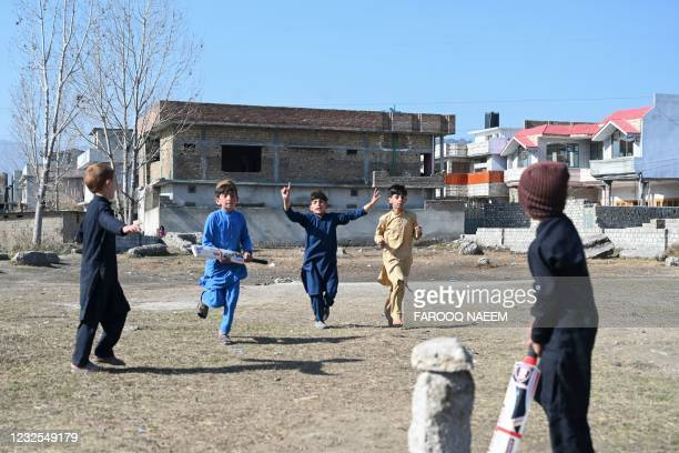 In this picture taken on February 11 children play cricket at the site of the demolished compound of slain former Al-Qaeda leader Osama bin Laden, in...