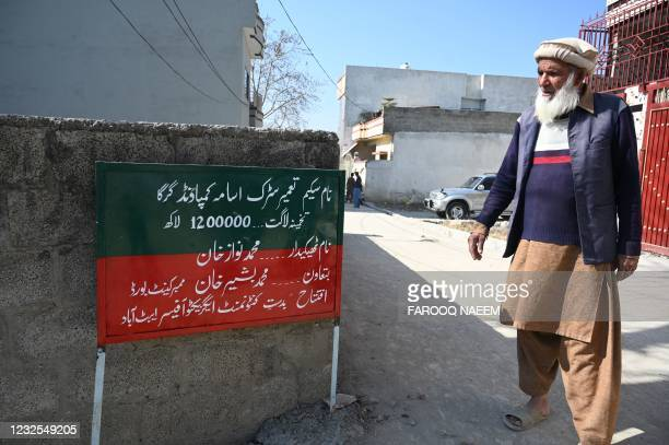 In this picture taken on February 11 local resident Altaf Hussain and neighbour of slain former Al-Qaeda leader Osama bin Laden, stands next to a...