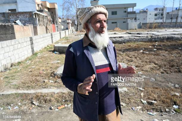 In this picture taken on February 11 local resident Altaf Hussain and neighbour of slain former Al-Qaeda leader Osama bin Laden, speaks with AFP at...