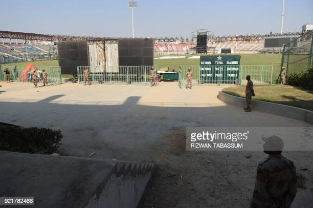 In this picture taken on February 11 Pakistani paramilitary soldiers stand guard at the National Cricket Stadium in Karachi during the full dress...