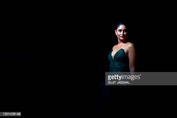 In this picture taken on February 16 Bollywood actress Kareena Kapoor Khan presents a creation by designers Amit Aggarwal during the Lakme Fashion...
