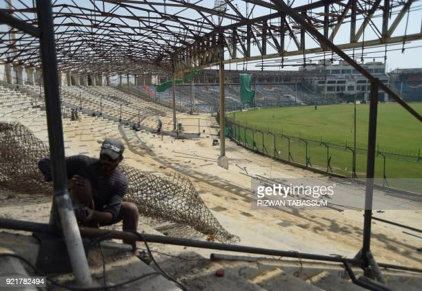 In this picture taken on February 17 a Pakistani labourer works at the National Cricket Stadium in Karachi Pakistan will launch the third edition of...