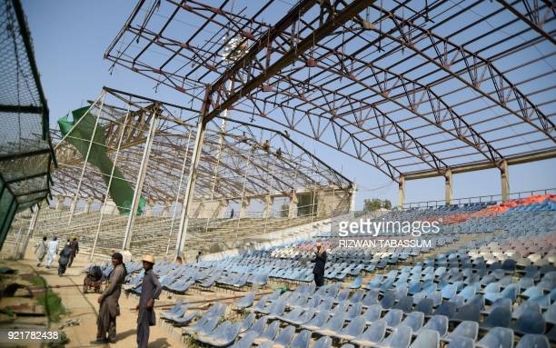 In this picture taken on February 17 Pakistani labourers work at the National Cricket Stadium in Karachi Pakistan will launch the third edition of...