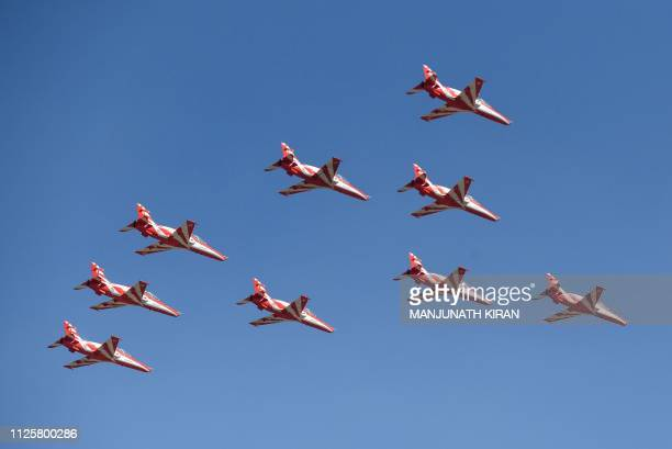 In this picture taken on February 18 Surya Kiran aircrafts fly in formation over the Yelahanka Air Force Station during flying rehearsals in...