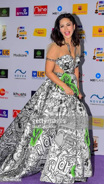 In this picture taken on February 19 Bollywood actress Sunny Leone poses for photographs as she arrives at the '12th Radio Mirchi Music Awards 2020'...