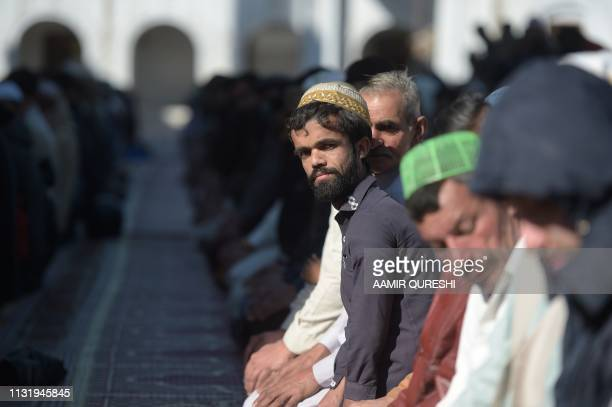 In this picture taken on February 22 Rozi Khan a 25yearold Pakistani waiter who resembles US actor Peter Dinklage offers Friday prayers at a mosque...