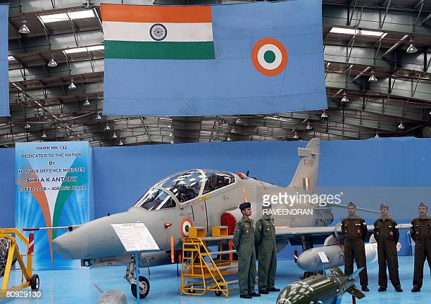 In this picture taken on February 23 Indian fighter pilots stand beside a Hawk Advanced Jet Trainer aircraft during an induction ceremony at Bidar...