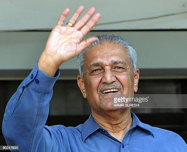In this picture taken on February 6 Pakistani nuclear scientist Abdul Qadeer Khan waves at his residence after a court verdict in Islamabad Khan who...