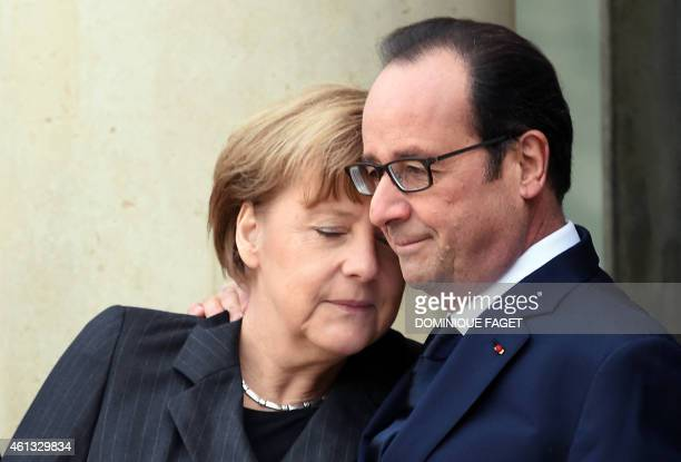In this picture taken on January 11 2015 French President Francois Hollande welcomes German Chancellor Angela Merkel at the Elysee Palace before...