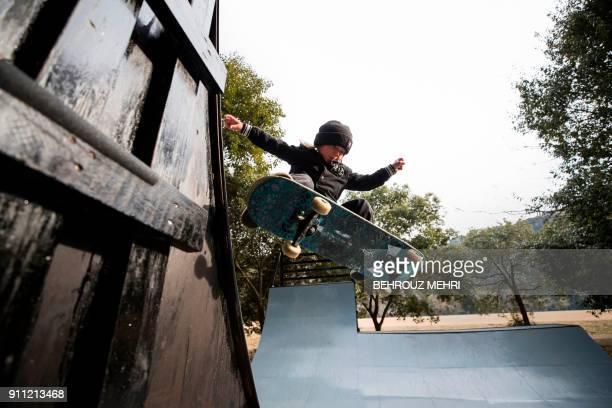 In this picture taken on January 14 Ocean Brown brother of nineyearold professional skateboarder Sky Brown shows off his skateboarding skills on the...